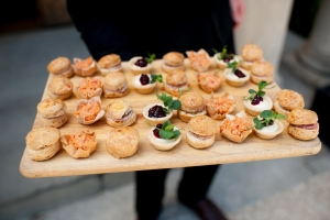A waiter holds out a board of canapes during a wedding at Leigh Court