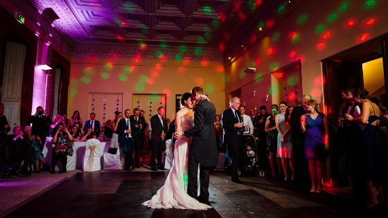 A wedding couple dance in the library at their Leigh Court wedding reception