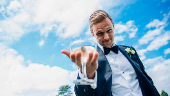 Groom with cocktail glass at his Leigh Court wedding